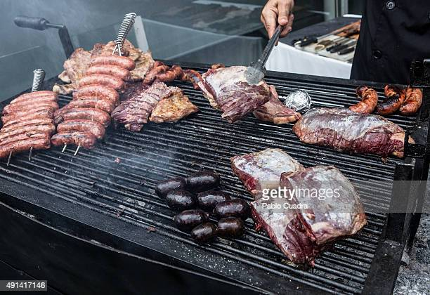 Grilled meat is offered during the Les Luthiers tour Presentation at Barclaycard Center on October 5 2015 in Madrid Spain