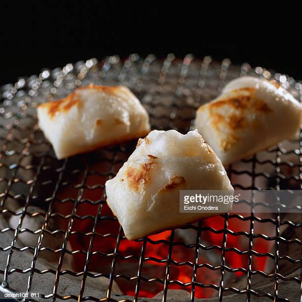 Grilled mochi over charcoal fire