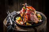 Grilled pheasant with bacon and vegetables and spices