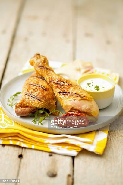 Grilled pieces of chicken with parmesan sauce