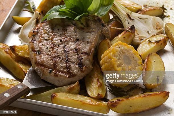 Grilled pork chop on roasted vegetables