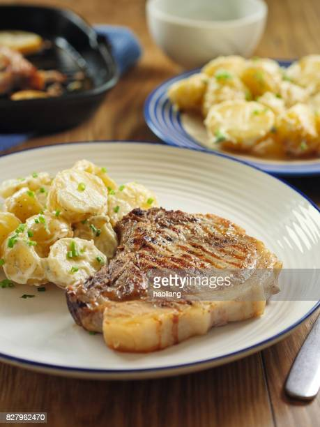 grilled pork chop with potato salad