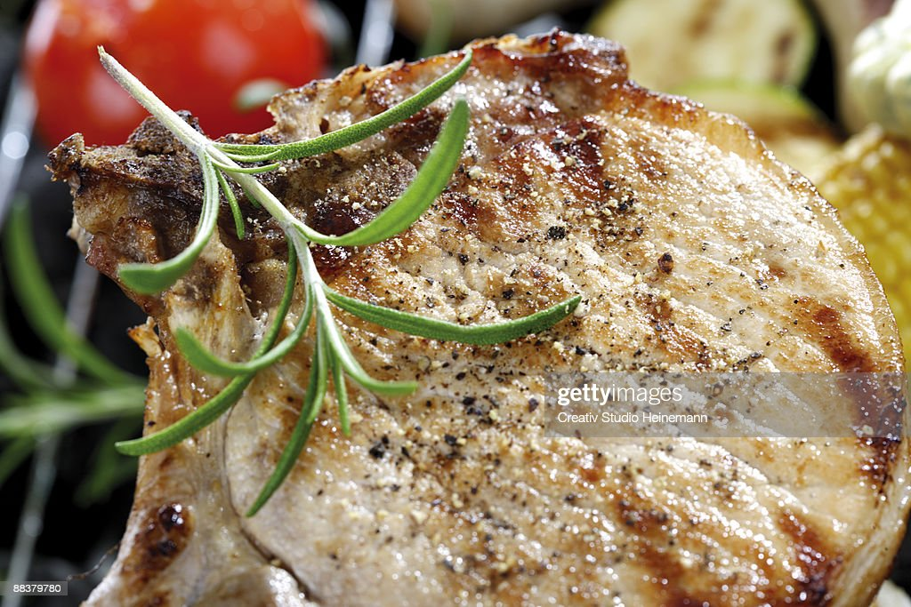 Grilled pork chop with rosemary, close-up : Stock Photo