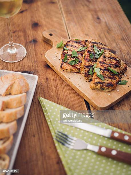 Grilled pork fillets on a wooden table ready for eating