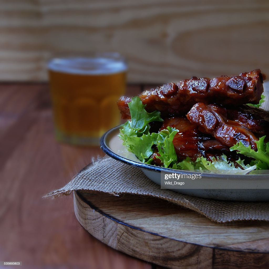 Grilled pork ribs with sauce and beer : Stock Photo