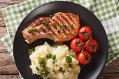 Grilled pork steak with mashed potatoes on a plate close-up. horizontal view from above