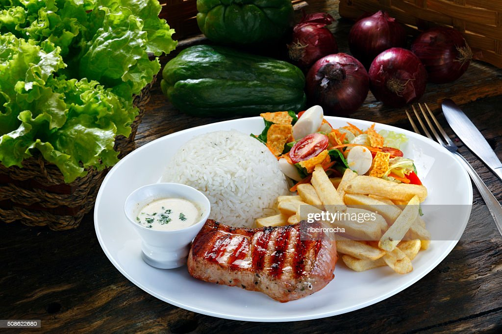 Grilled pork with fries and vegetables : Stock Photo
