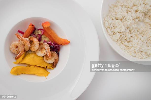 Grilled prawns with mango and curry. Basmati rice.