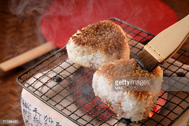 Grilled rice balls over charcoal fire