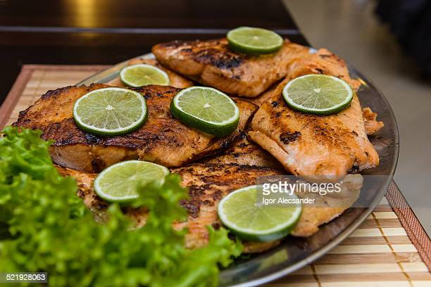 Grilled salmon on restaurant tray