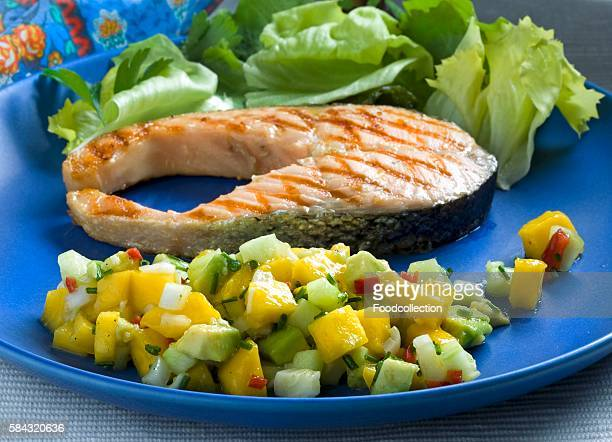 Grilled salmon steak with a mango and avocado salsa