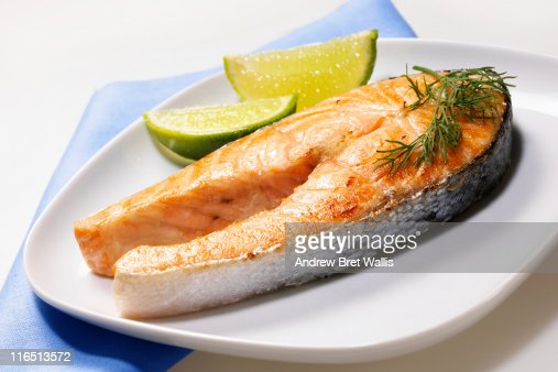 Grilled salmon steak with lime slices : Stock Photo