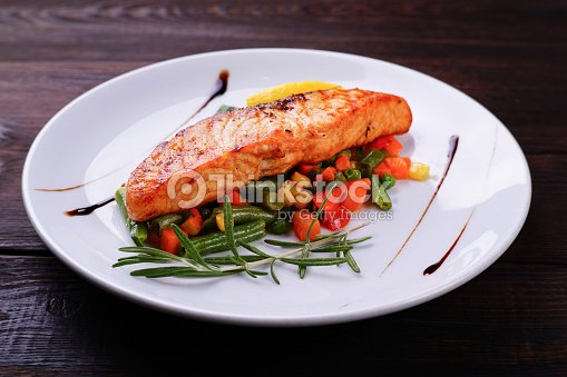 Grilled salmon steak with vegetable garnishing : Stock Photo