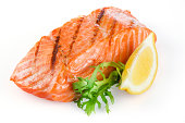 Grilled salmon with lemon isolated on white