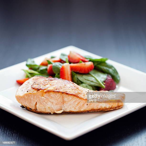 Grilled salmon with strawberry spinach salad
