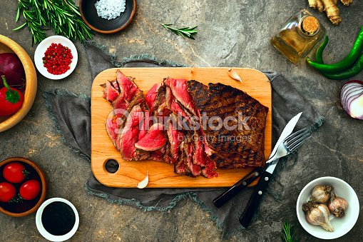 Grilled skirt steak served on a cutting board : Stock Photo