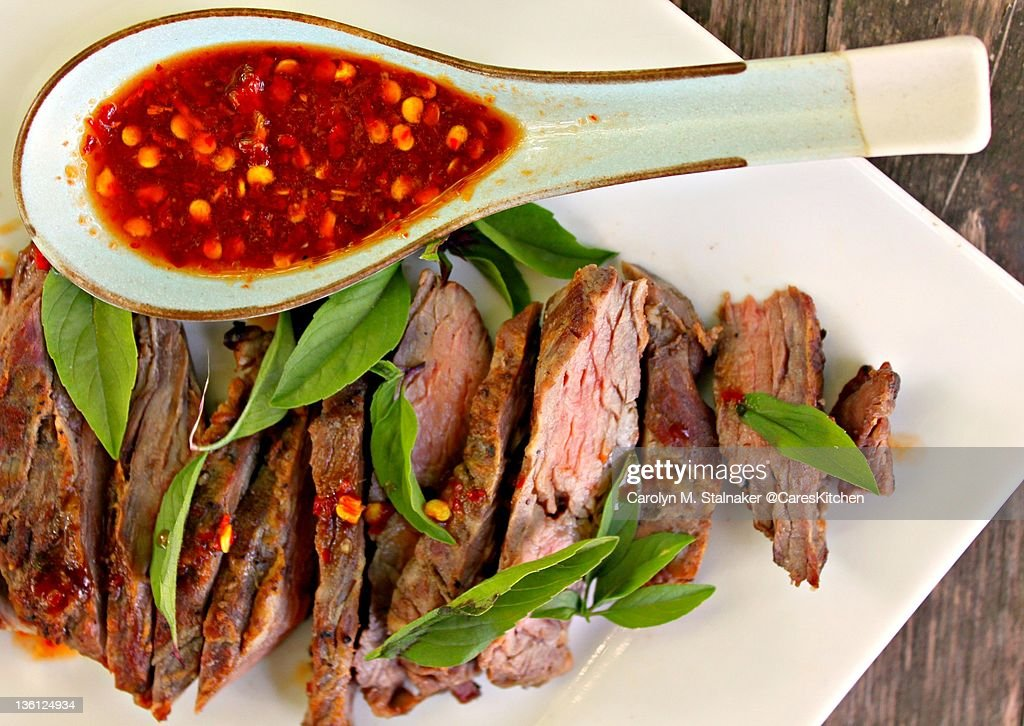 Grilled skirt steak with red Thai chili sauce : Stock Photo