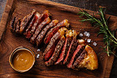 Grilled sliced Steak Striploin with Pepper sauce close-up
