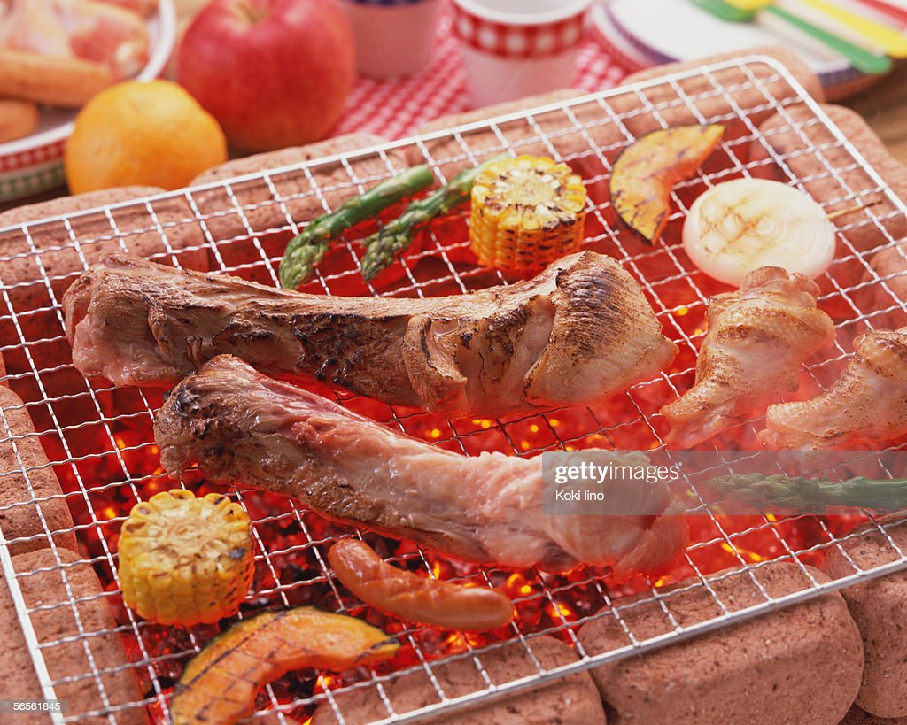 Grilled spareribs over charcoal : Stock Photo