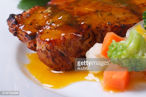 Grilled steak meat with sauce and vegetable : Stock Photo