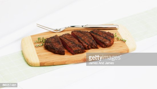 Grilled steak on cutting board : Stock Photo