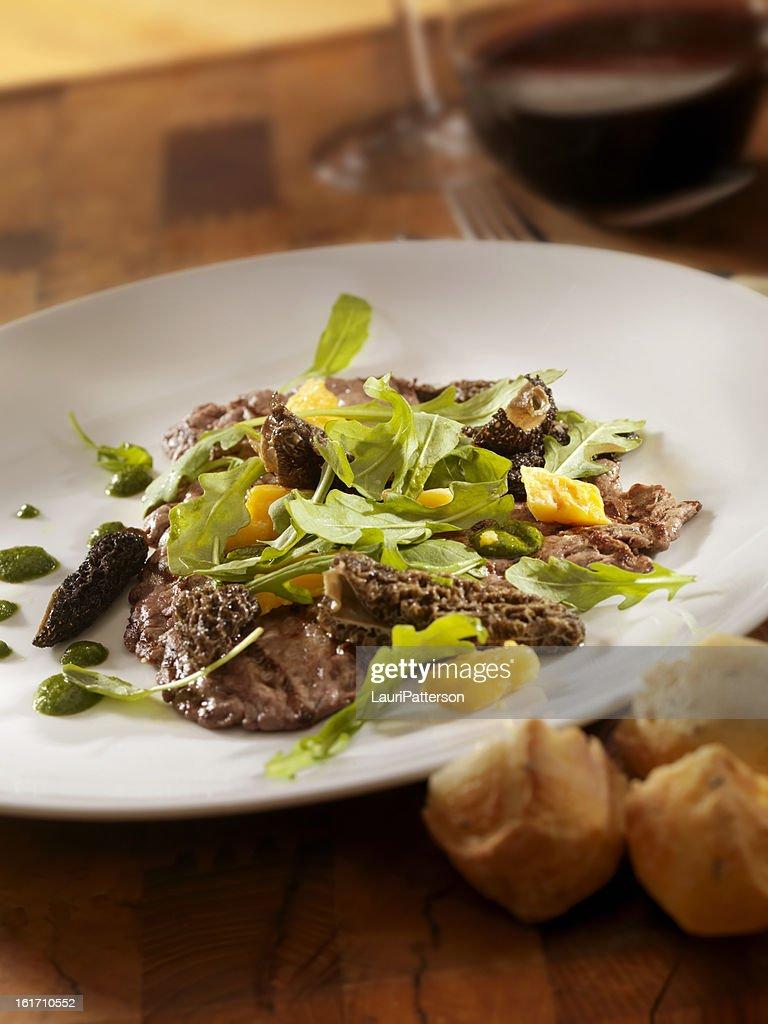 Steak grillé aux champignons et roquette : Photo
