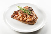 Dish with Grilled t-bone chop of pork