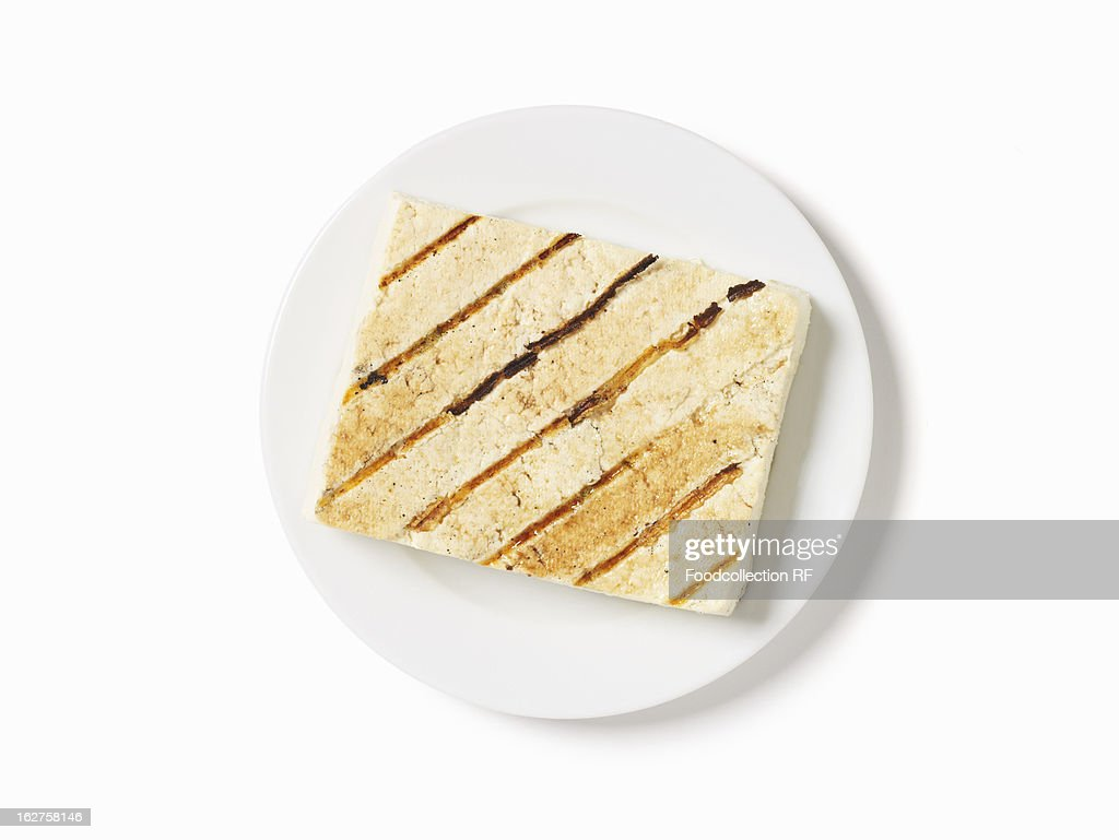 Grilled tofu on white plate : Stock Photo