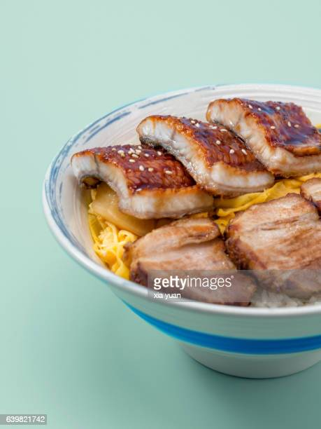 Grilled Unagi And Char Siu Over Rice In Bowl