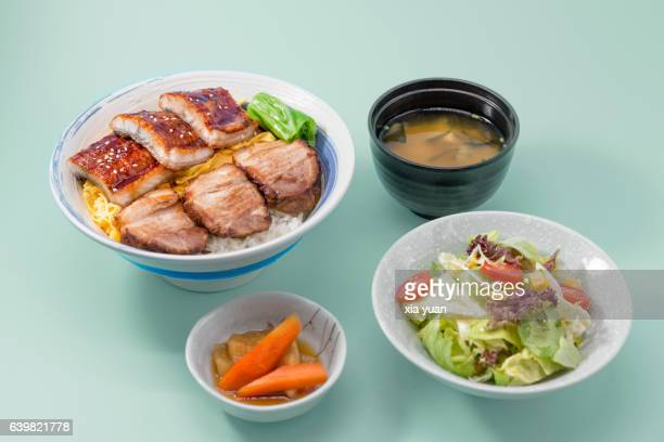 Grilled Unagi and Char Siu over rice, miso soup and pickled radish