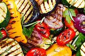 Grilled vegetables. On cutting dark board background.