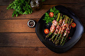 Grilled violet asparagus wrapped with bacon. Top view
