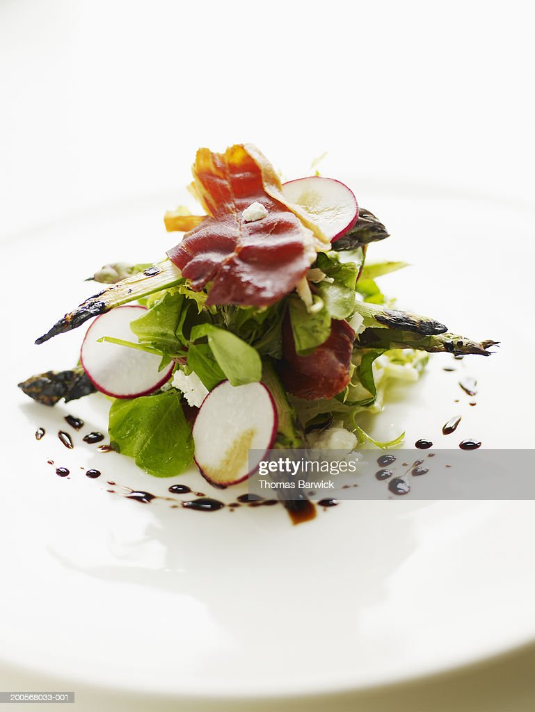 Grilled Yakima asparagus with chevre, prosciutto and 12 year balsamic : Stock Photo