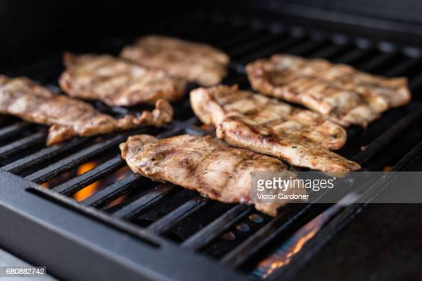 Grilling marinated turkey breast on a gas babrbecue