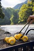 Grilling sweet corn on BBQ
