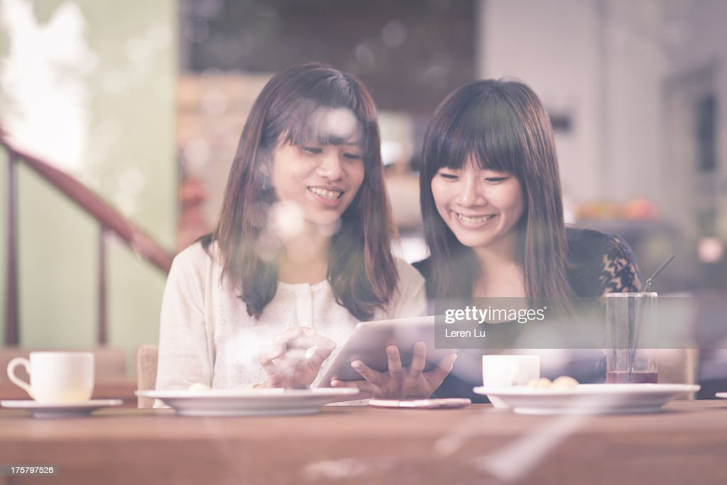 Grils relaxed in coffee store : Stock Photo