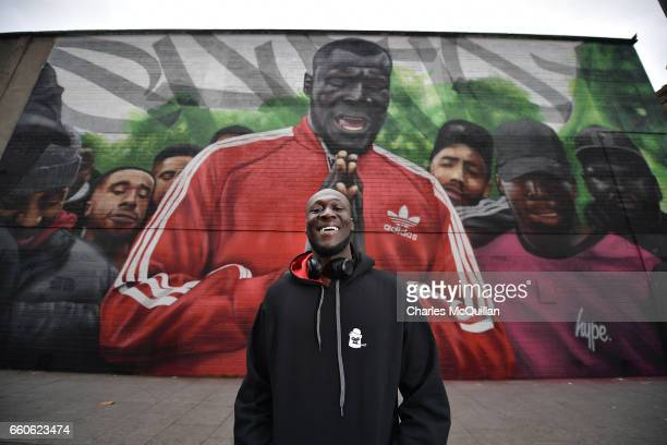 Grime artist Stormzy visits a mural depicting a scene from his video 'Shut Up' at Smithfield on March 30 2017 in Dublin Ireland Stormzy performed in...