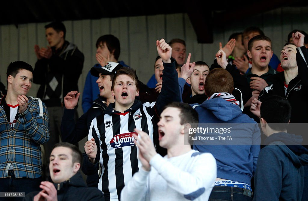 Grimsby fans celebrate at full time of the FA Trophy semi final match between Grimsby Town v Dartford at Blundell Park on February 16, 2013 in Grimsby, England.