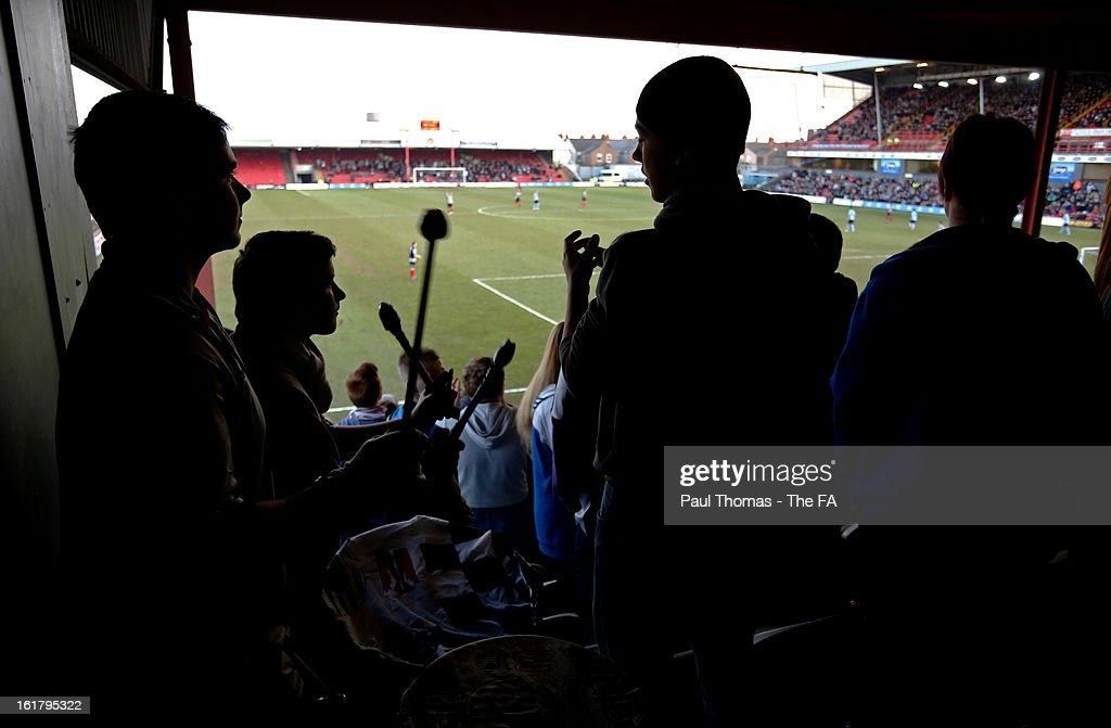 Grimsby fans play the drums and sing during the FA Trophy semi final match between Grimsby Town v Dartford at Blundell Park on February 16, 2013 in Grimsby, England.