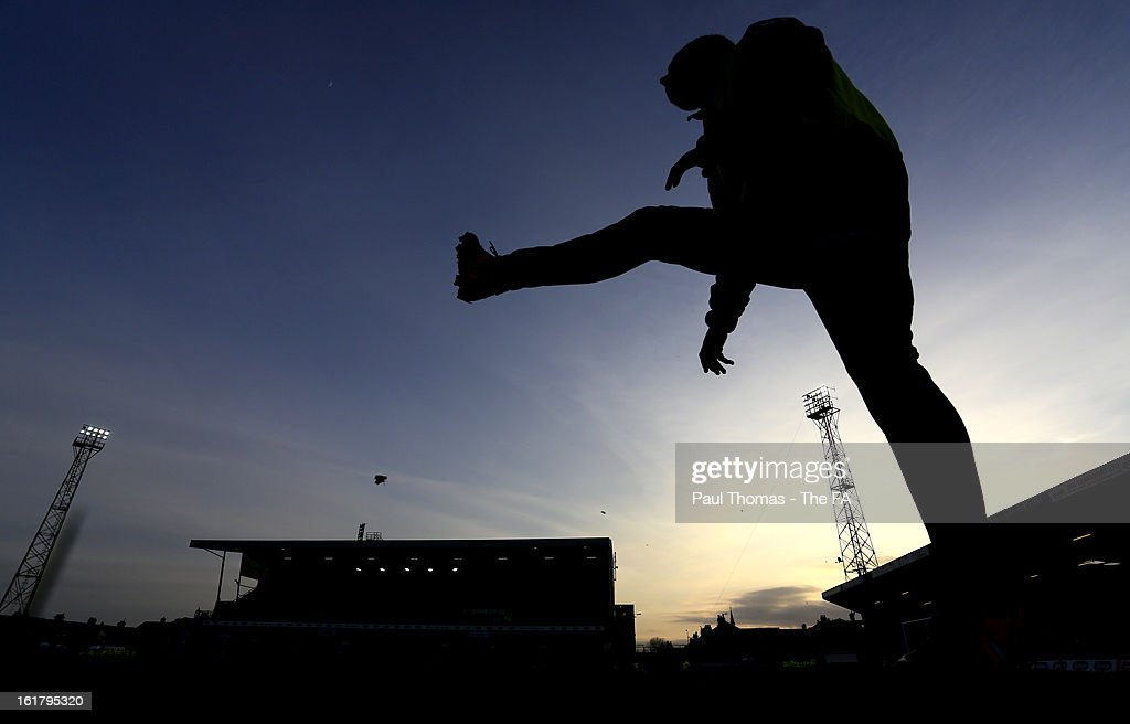 A Grimsby player warms up along the sideline during the FA Trophy semi final match between Grimsby Town v Dartford at Blundell Park on February 16, 2013 in Grimsby, England.
