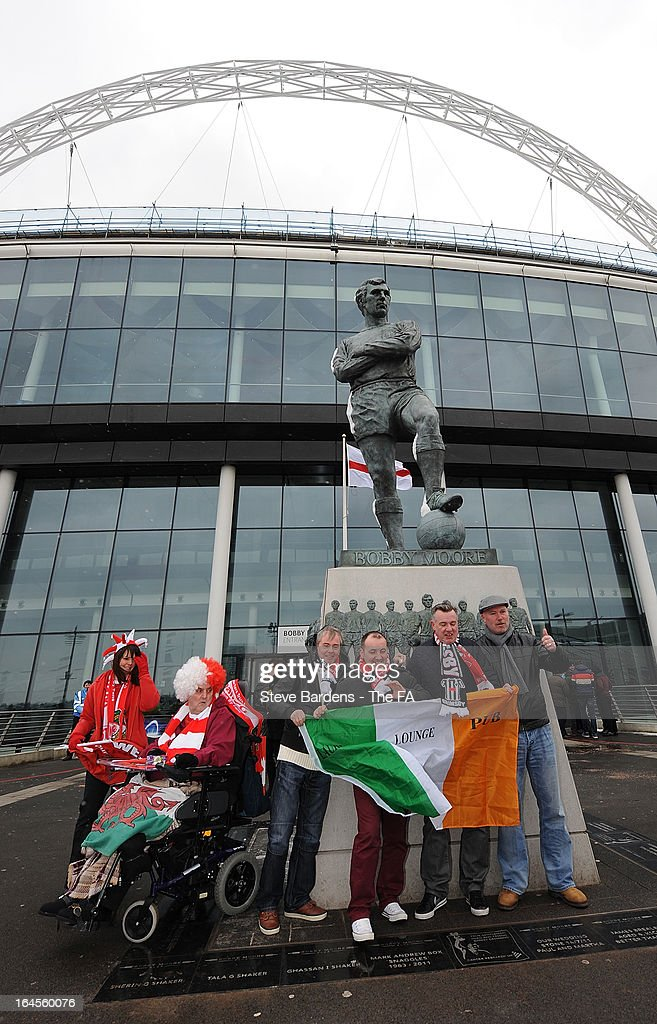 Grimsby Town and Wrexham supporters beside the Bobby Moore statue outside Wembley Stadium before the FA Trophy Final between Wrexham and Grimsby Town at Wembley Stadium on March 24, 2013 in London, England.