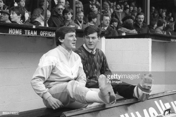 Grimsby Town captain Kevin Moore and brother fullback Andy Moore with their legs in plaster watching from the sidelines during the FA Cup third round...