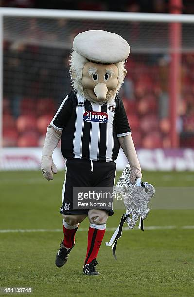 Grimsby Town mascot Mighty Marriner leaves the pitch holding a homemade FA Cup prior to the FA Cup with Budweiser Second Round match between Grimsby...