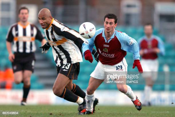 Grimsby Town's George Santos and Burnley's Dimitrios Papadopoulos go for the ball