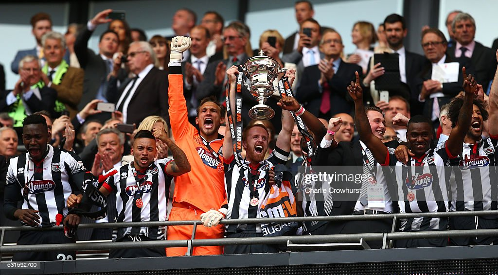 Grimsby's Craig Disley lifts the trophy as he celebrates the teams win and promotion to the football league during the Vanarama Football Conference League Play Off Final between Forest Green Rovers and Grimsby Town at Wembley Stadium on May 15, 2016 in London, England.