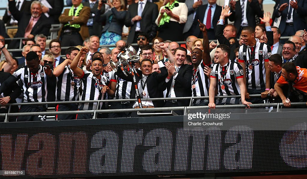 Grimsby's manager Paul Hurst lifts the trophy as he celebrates the teams win and promotion to the football league during the Vanarama Football Conference League Play Off Final between Forest Green Rovers and Grimsby Town at Wembley Stadium on May 15, 2016 in London, England.