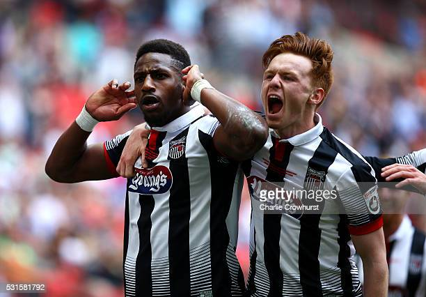 Grimsby's Omar Bogle celebrates with team mate Jon Nolan after scoring his and the teams second goal of the game during the Vanarama Football...