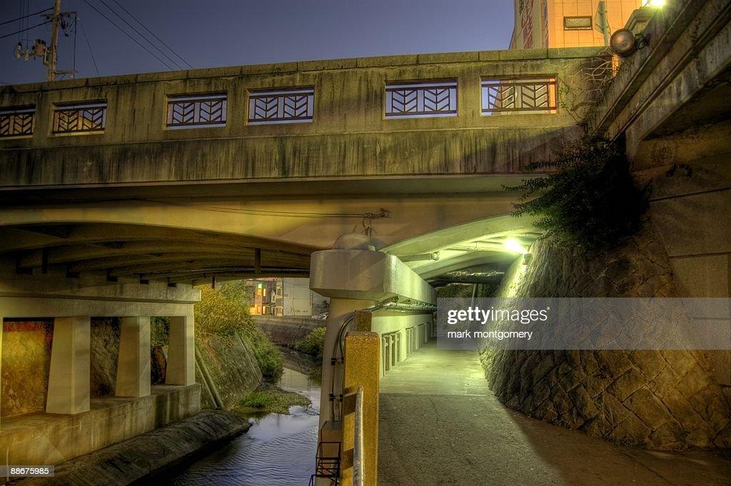 Grimy Bridge over daylight River