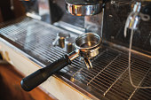 Grinder handle on coffee maker on counter bar
