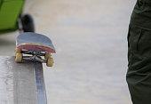 Skateboard sitting on a rail at Venice Skate Park in Venice Beach California